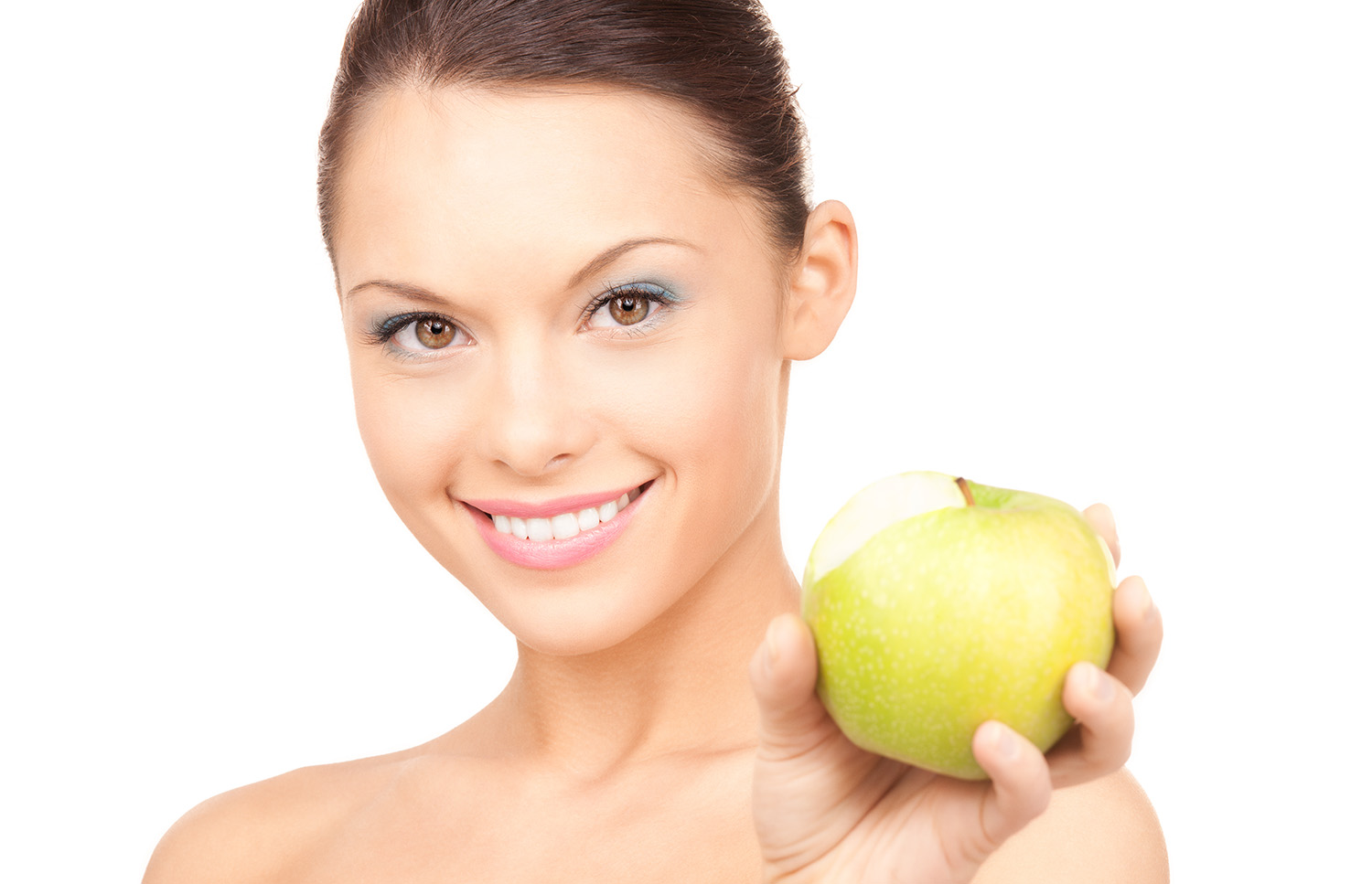 Young woman with green apple   Buckingham Dental
