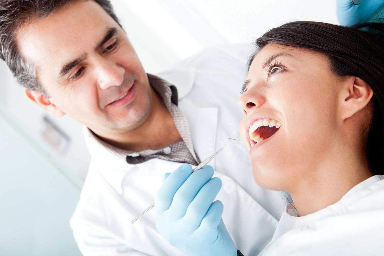 Dentist with patient | Buckingham Dental